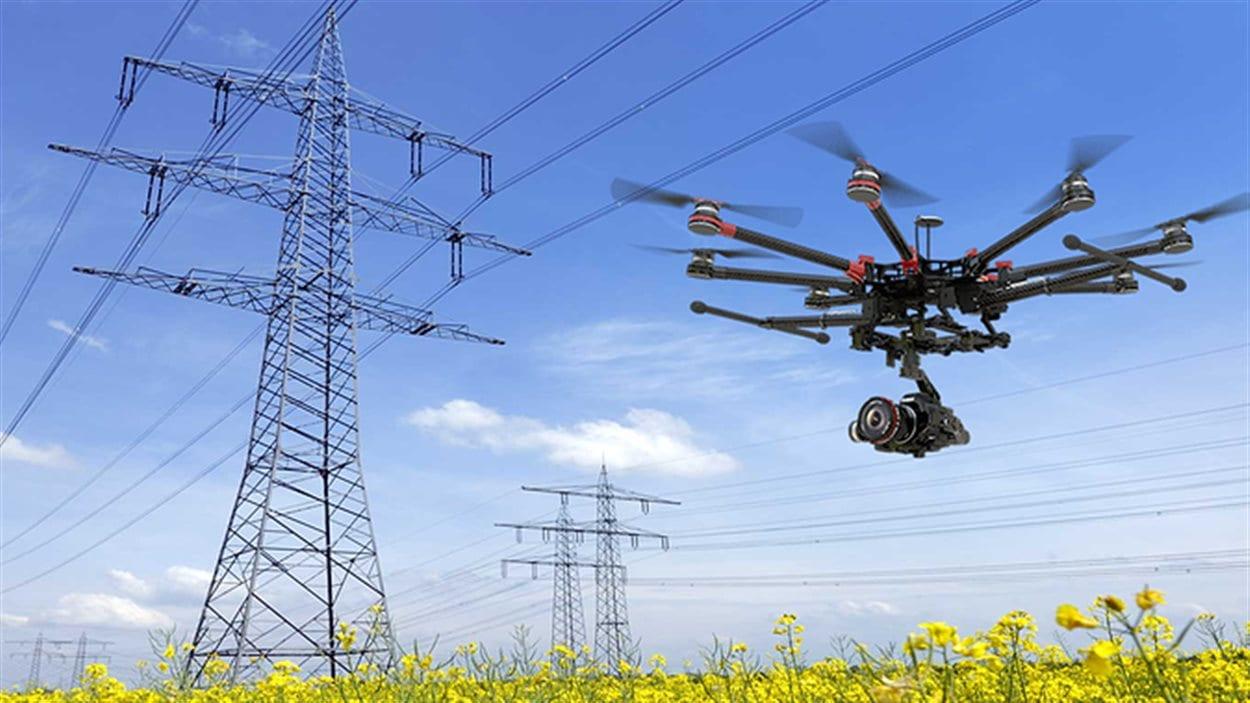 Une compagnie de Grand Forks en C.-B. lance des cours de pilotage de drone. Un drone vole pres de lignes à haute tension