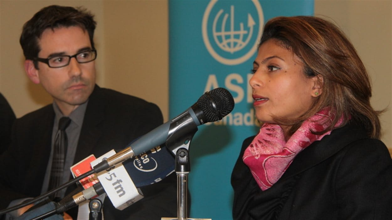Ensaf Heidar, the wife of jailed Saudi blogger Raif Badawi, speaks at a presse conference with the executive director of Lawyers Without Borders Pascal Paradis in Montreal on Nov. 3, 2015