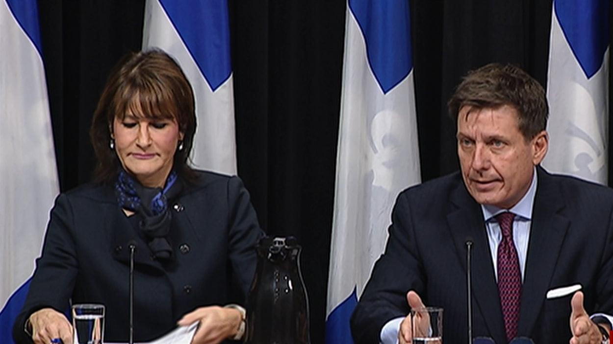 La ministre québécoise de l'Immigration, de la Diversité et de l'Inclusion, Kathleen Weil et Pierre Moreau, ministre intérimaire de la Sécurité publique du Québec.