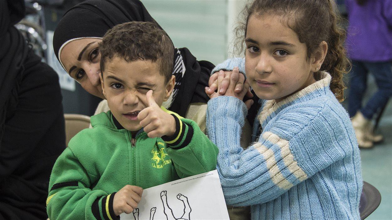 Des réfugiés syriens à Beyrouth, au Liban, avant leur départ pour le Canada, le 9 décembre