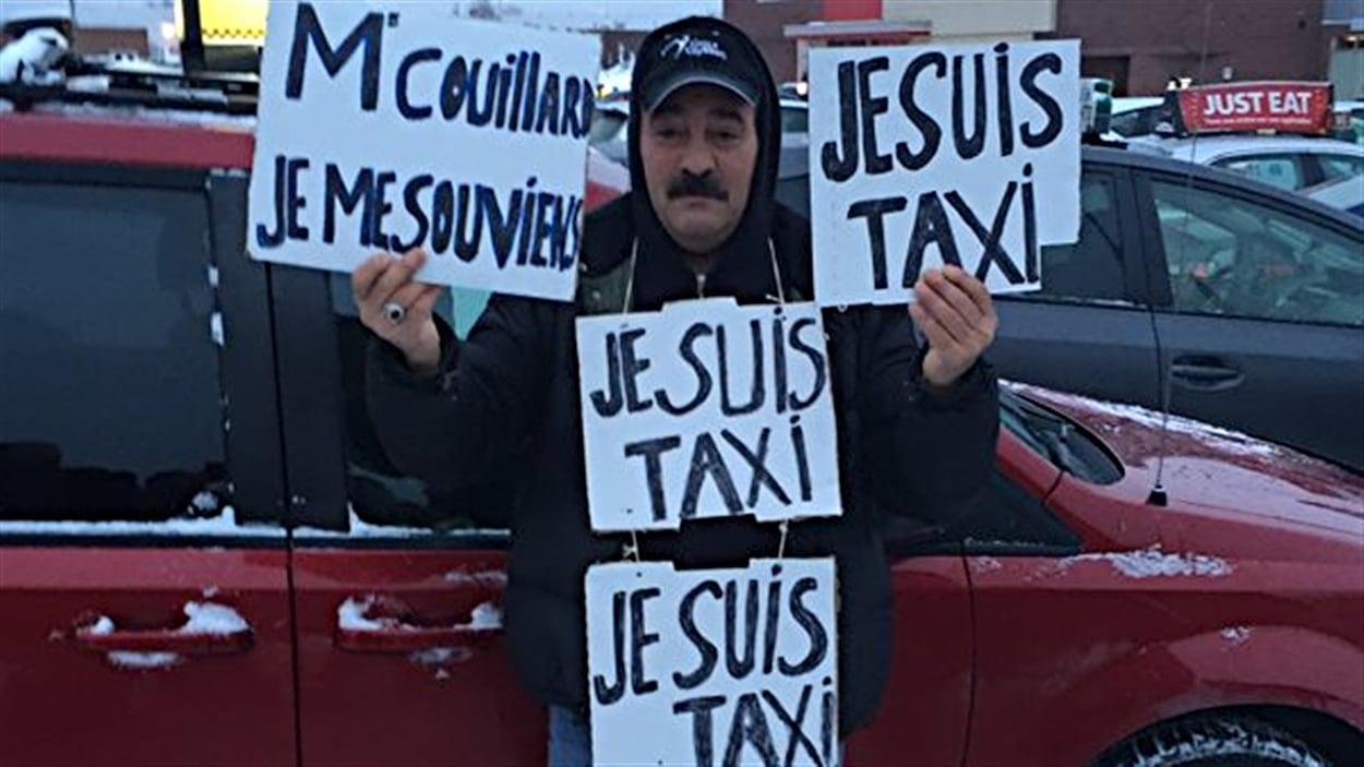 Un chauffeur de taxi de la région de Montréal dénonce la présence d'Uber dans son industrie.