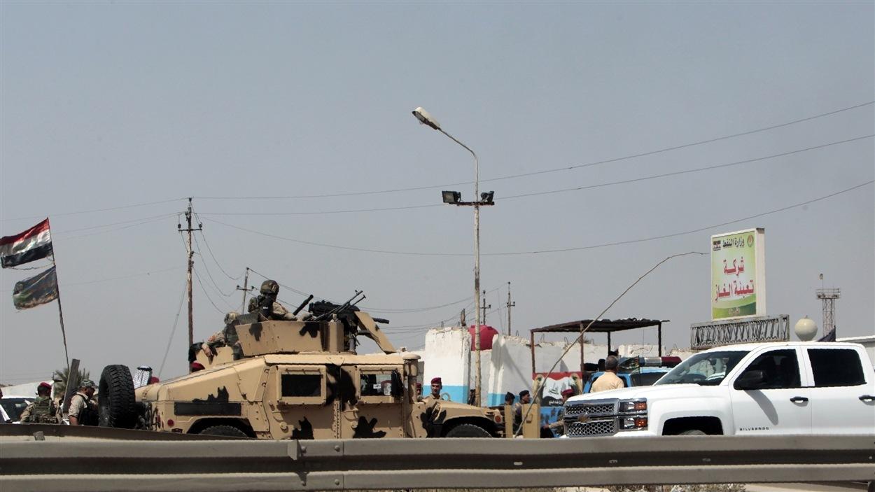 Les tirs qui ont suivi l'explosion d'une voiture piégée sur le site de l'usine irakienne ont duré pendant près d'une heure.