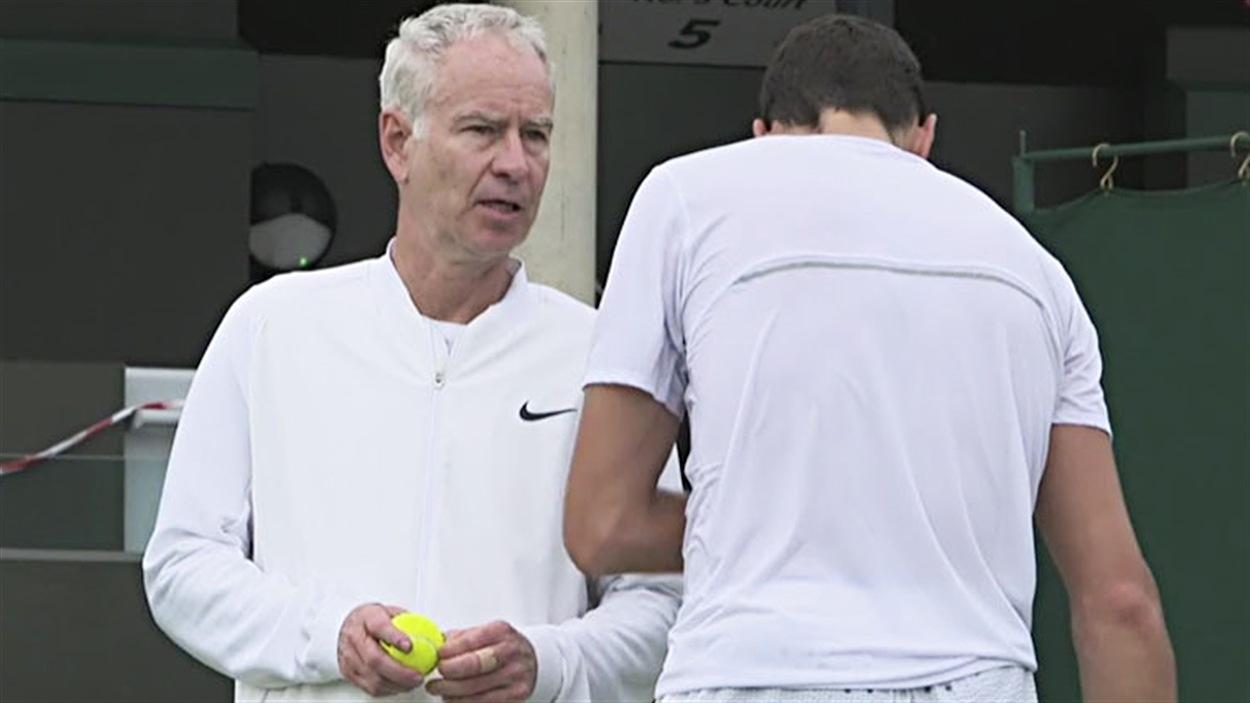 John McEnroe et Milos Raonic