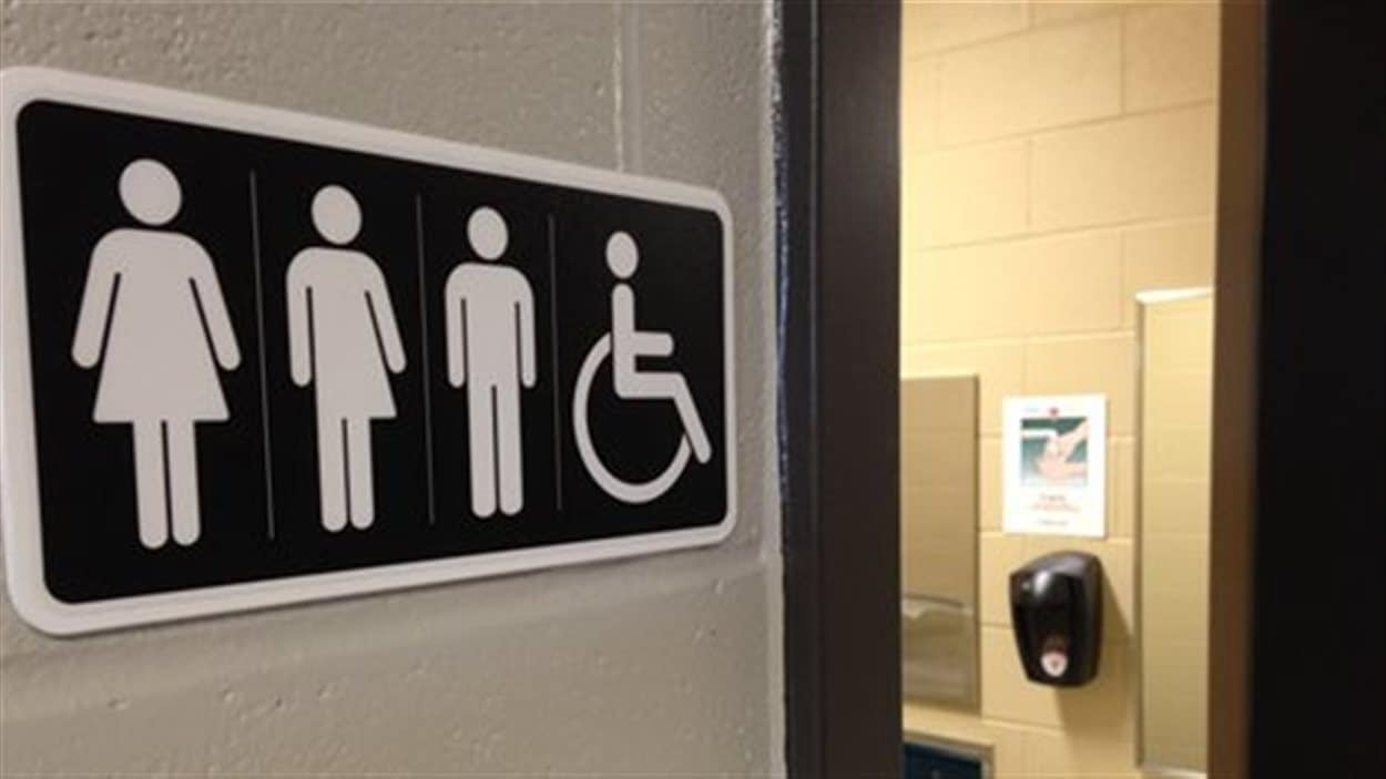 Un pictogramme montrant des toilettes unisexes.
